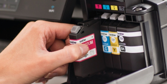 Person replacing ink in a Brother printer