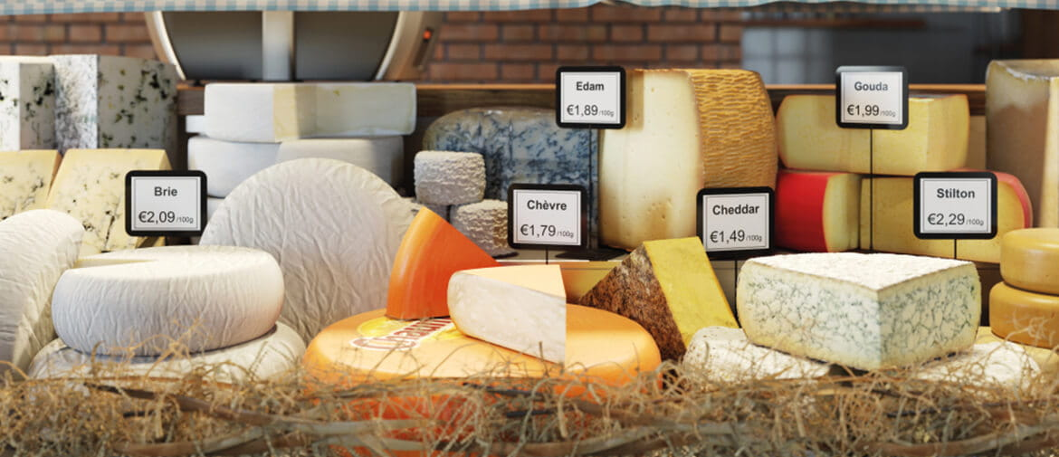 A selection of cheese on a deli counter labelled with a brother labeller