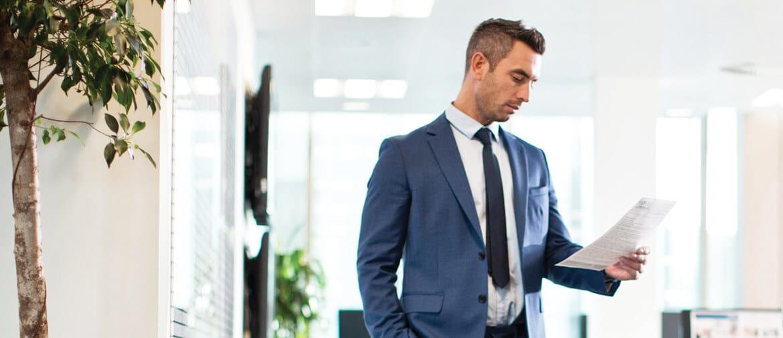 Man in office reading checklist for best printer toner
