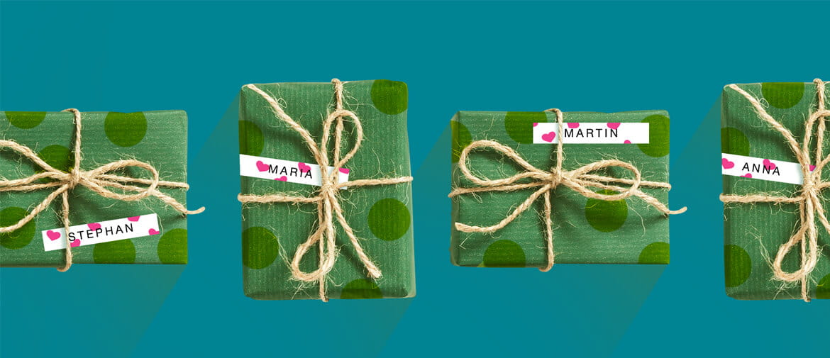 Green presents wrapped with string on a teal background