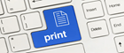 A close up of a standard QWERTY keyboard with the enter/print key in blue with a document icon and the word print written on it