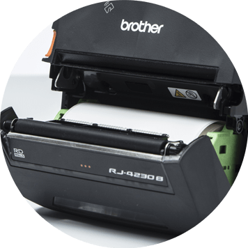 Brother RJ mobile printer open showing roll of label