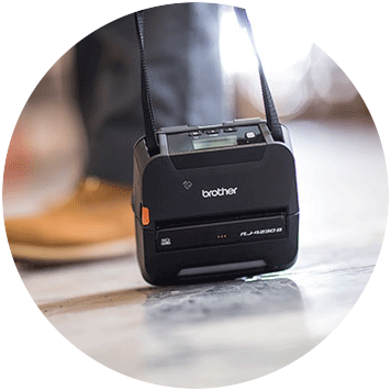 Brother RJ-4 rugged mobile printer dropped on floor with shoulder strap