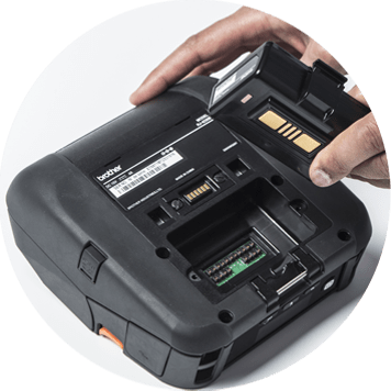 Hand taking battery out of a mobile printer