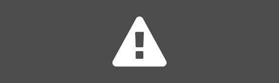 white hazard warning sign icon against an grey background