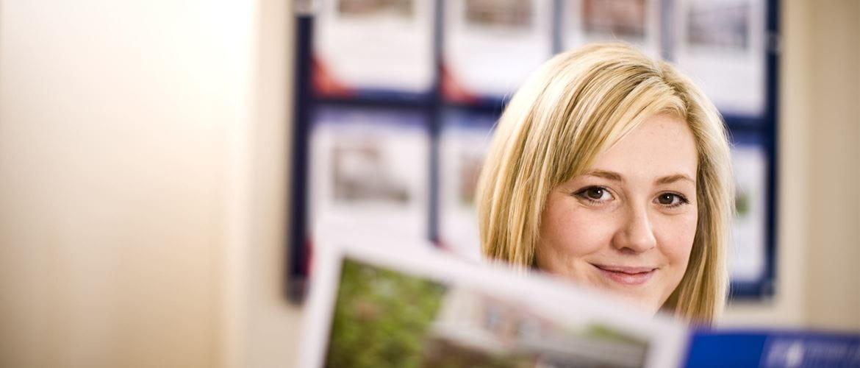 woman reading a leaflet