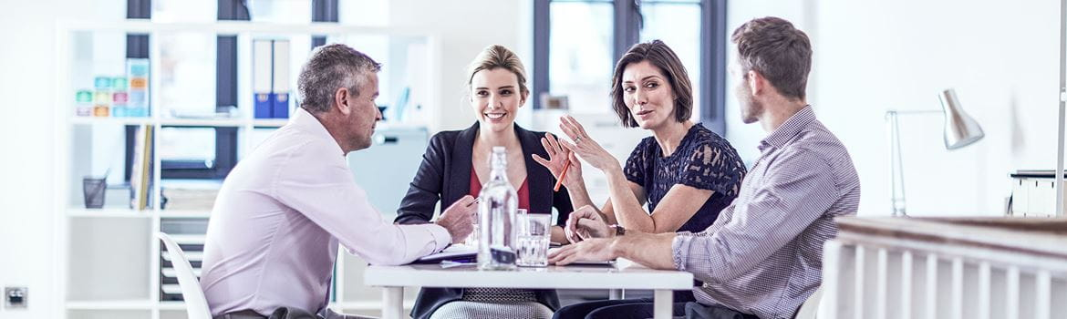 business people sat around a table in a professional environment