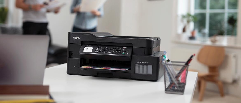 Brother MFC-J895DW inkjet on desk with laptop