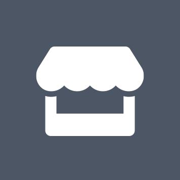 Sivi krog z belo ikono trgovine