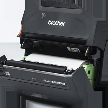 Imprimantă mobilă Brother RJ deschisă care arată rola de etichete albe