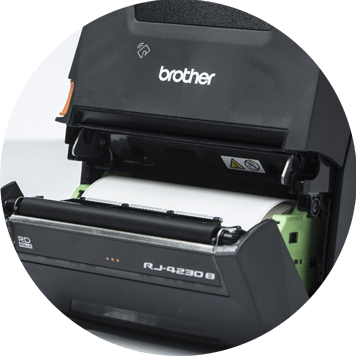 Nyitott Brother RJ mobil nyomtató,  fehér tekercs címkékkel