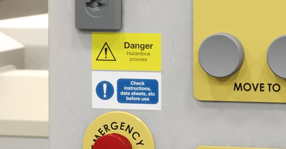 Two Brother P-touch labels on a control panel, warning of danger and to check instructions before use