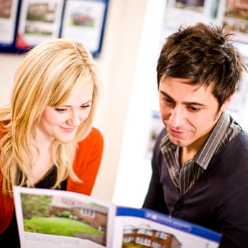 man and woman reading a leaflet