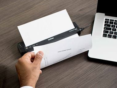 A salesman prints an A4 page from the Brother PJ series portable printer