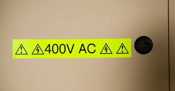 Brother fluorescent tape warning sign showing 400 volts AC