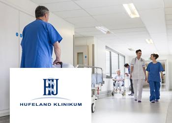Krankenhauspersonal mit Patienten