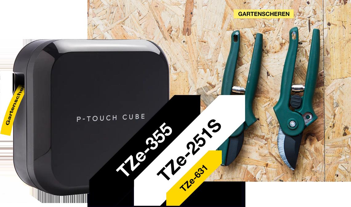 Schwarzer P-touch CUBE Plus mit TZe-Schriftbändern daneben, Anwendungsbild mit Werkzeugwand und zwei grünen Gartenscheren im Hintergrund
