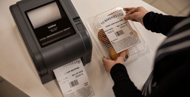 Packet of cookies being labelled with label from Brother TD-4T printer