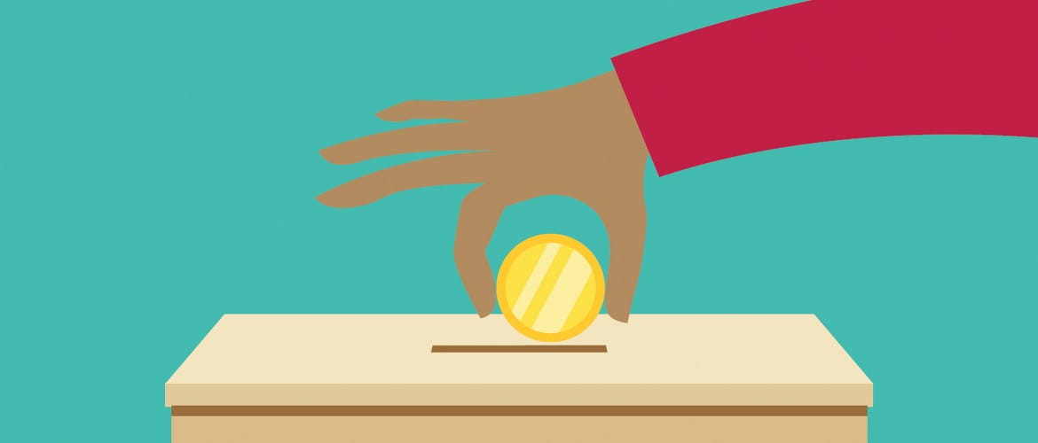 A cartoon graphic to signify charitable donations shows a hand donating a gold coin in a wooden charity collection box against a solid teal background