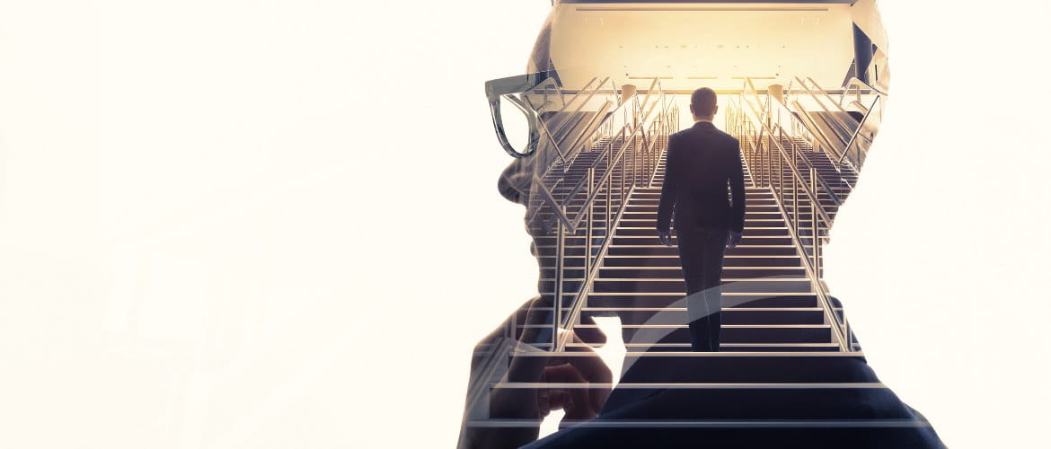 Office of the future image depicting a thinking man in a suit and a staircase of a business