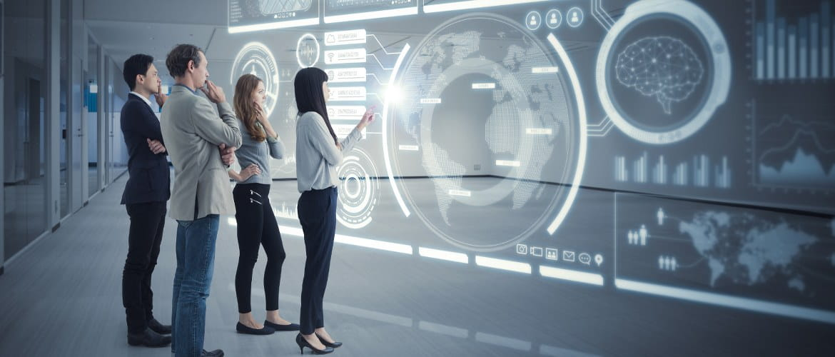 Four office workers (two male, two female) in a future workspace use holographic technology during a business meeting to collaborate on a project