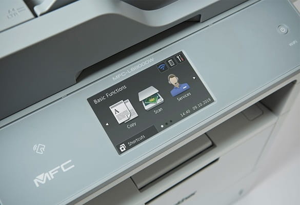 Close up photo of the Brother MFC-L6800DW printer LCD touchscreen showing the Request Help solution to contact the services team