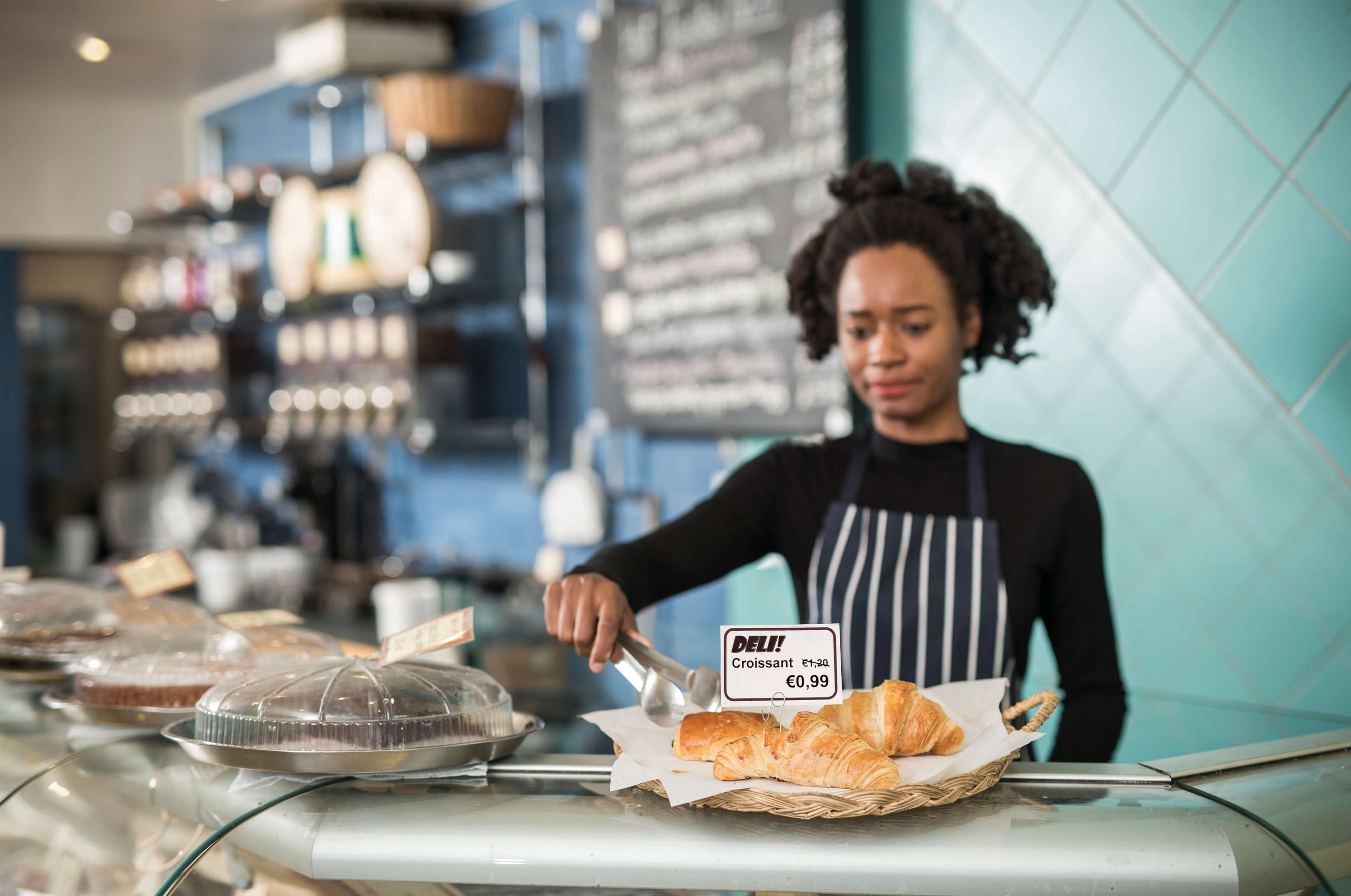 Woman in bakery labelling food products