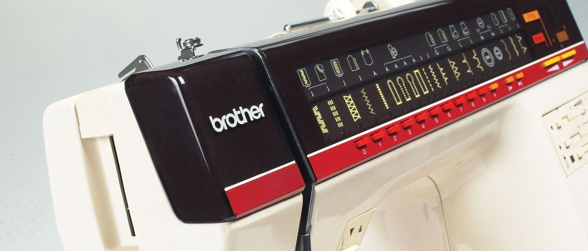 Cream, black and red Brother sewing machine
