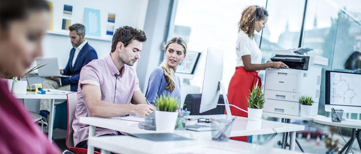 Professionals talk and collaborate in office setting