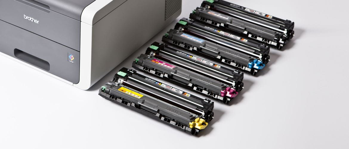 Original Brother toner cartridge supplies next to a Brother printer
