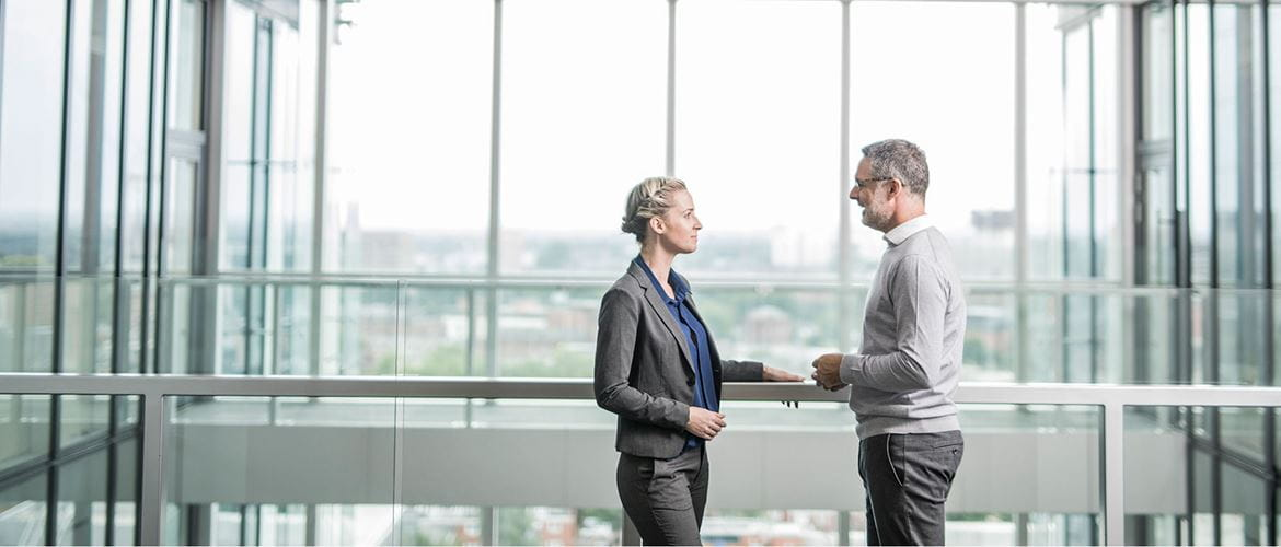 Business man and woman meeting in an office