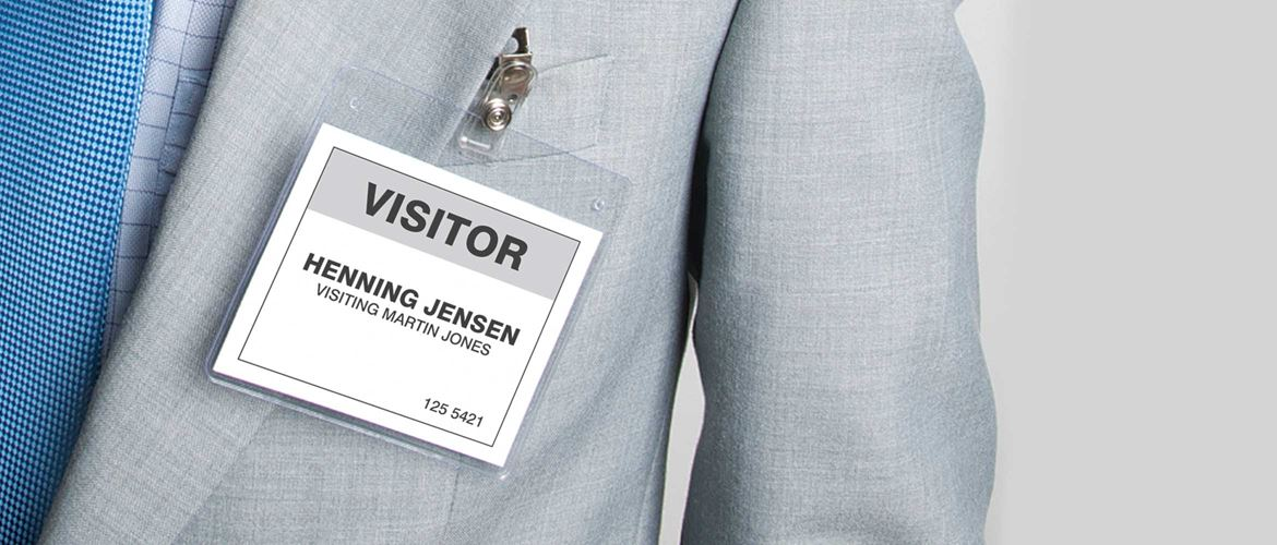 Visitor badge on man dressed in suit