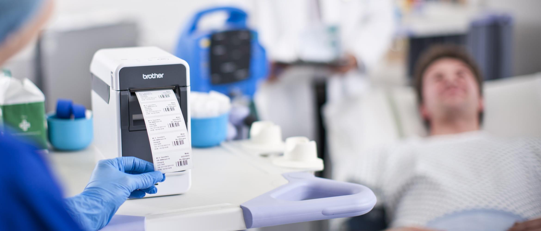Nurse printing labels bedside