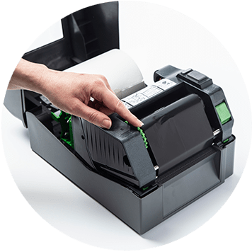 Brother TD-4T desktop label printer open with hand rolling thermal ribbon