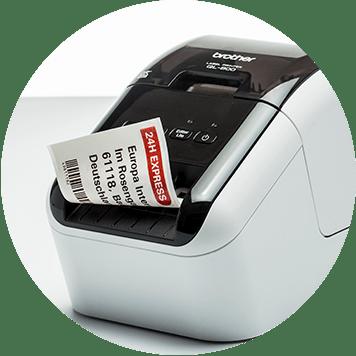 Brother QL desktop label printer with red and black label