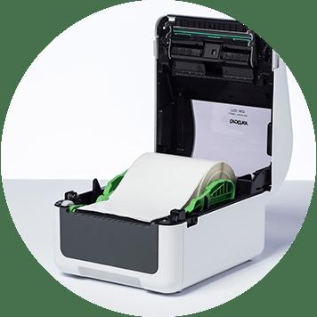 Brother TD-4D desktop label printer open with label roll inside