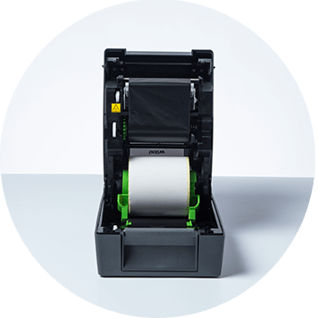 Brother TD-4T desktop label printer open with labels and ribbons on show