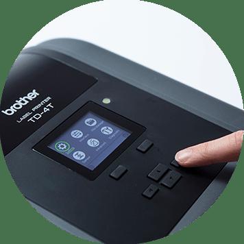 Brother TD-4T desktop label printer with finger pressing buttons