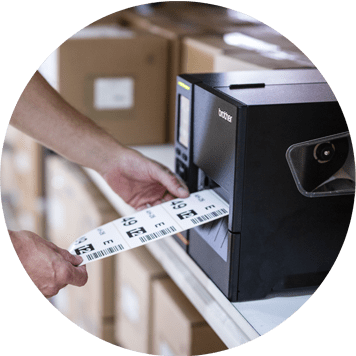 Brother black label machine printing label with barcode, hand holding labels