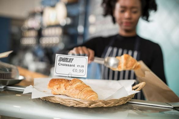 In-store food label on croissants showing price reduction