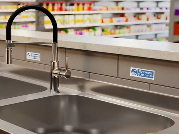 Blue on white waterproof P-touch TZe labels near sink to remind staff to wash their hands