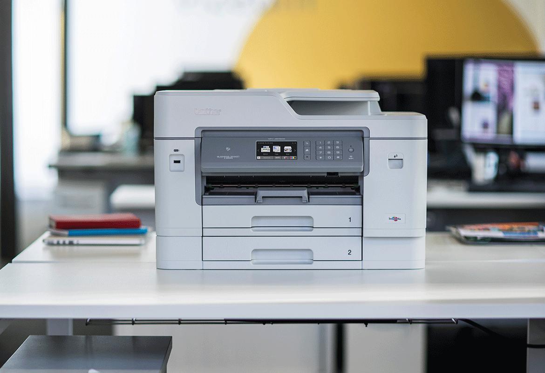 Brother multifunction inkjet printer sat on desk in office
