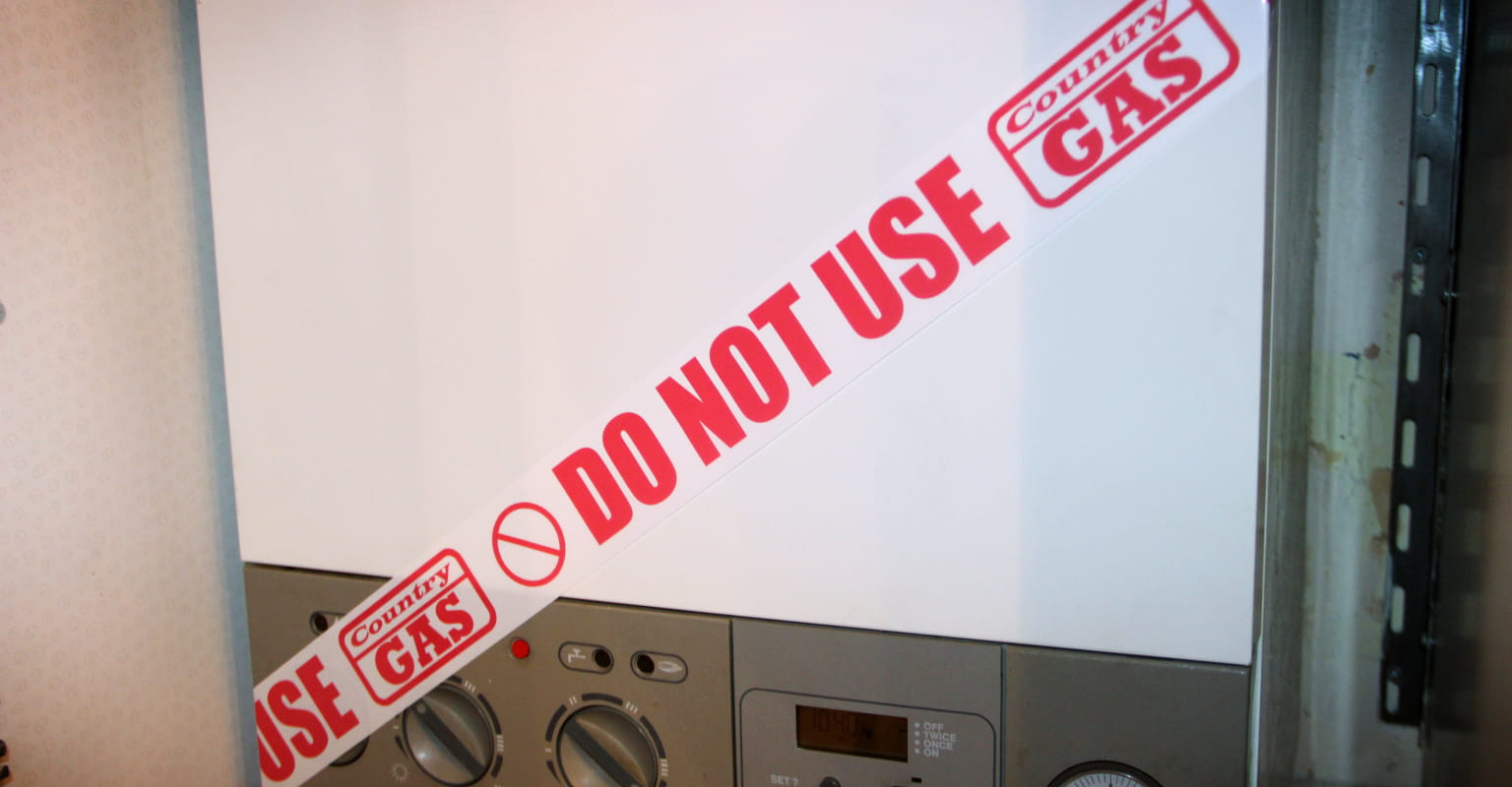 "Customised adhesive roll wrapped around a faulty gas boiler stating ""Do not use"""