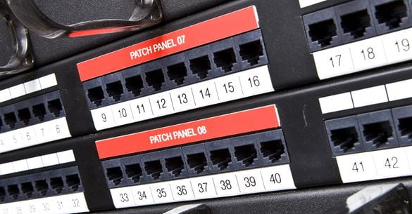 Standard P-touch TZe labels on a network patch panel