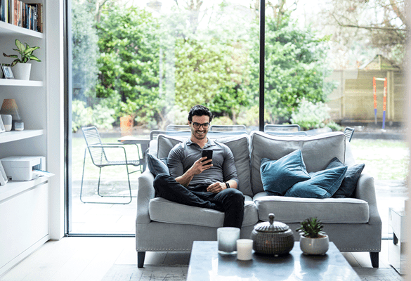 Man using mobile phone at home