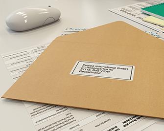 Štítek s adresou na obálce vytištěné na tiskárně štítků Brother