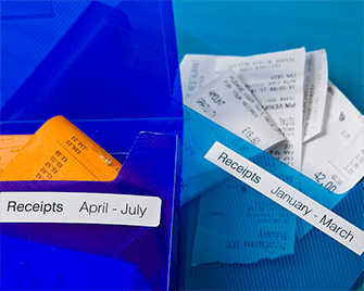 Document wallets containing receipts labelled with Brother DK labels