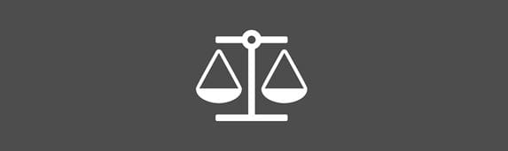 White balancing scales icon against a grey background