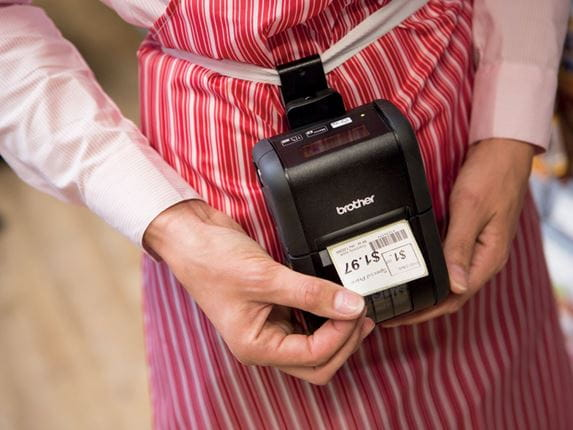 Brother RJ portable label printer producing barcode label