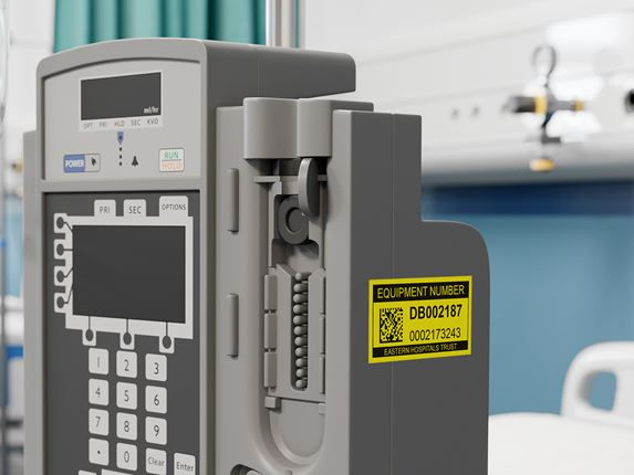 Brother P-touch black on yellow asset label on hospital medical equipment